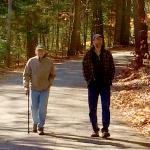 Carl & Darrel walking near the lake house.